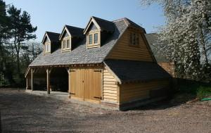 Oak framed 3 bay garage with room over - built by Shires Oak