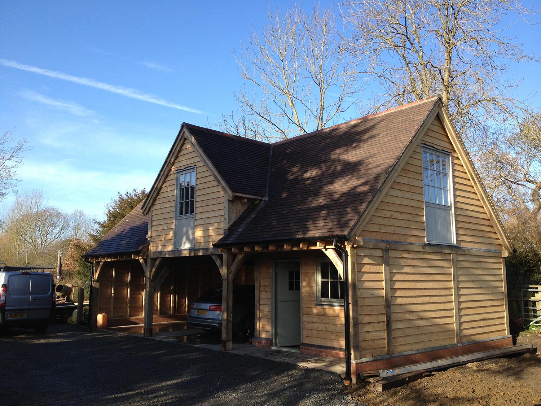 Oak framed garage and studio by Shires Oak Buildings