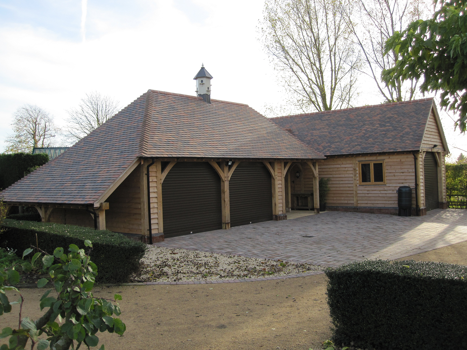 Oak framed garden store by Shires Oak Buildings