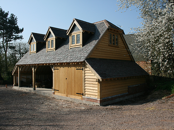 Oak framed 3 bay garage with room above by Shires Oak Buildings