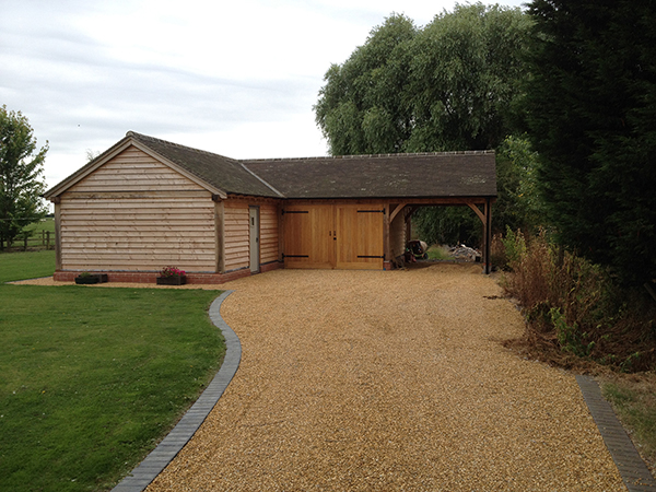 Oak framed garage and garden store by Shires Oak Buildings