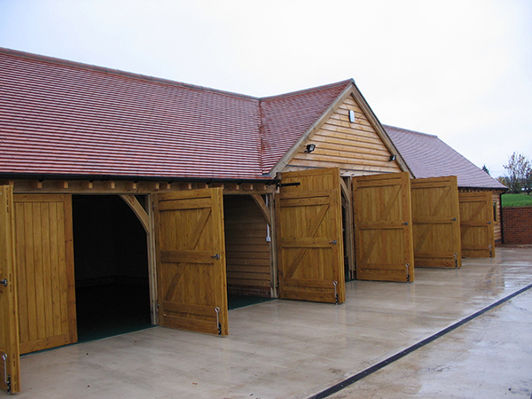 Oak framed garage complex by Shires Oak Buildings