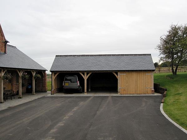 Oak framed 3 bay garage and walkway project by Shires Oak Buildings