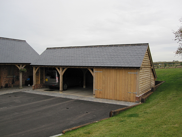 Oak framed 3 bay garage and walkway project by Shires Oak Buildings