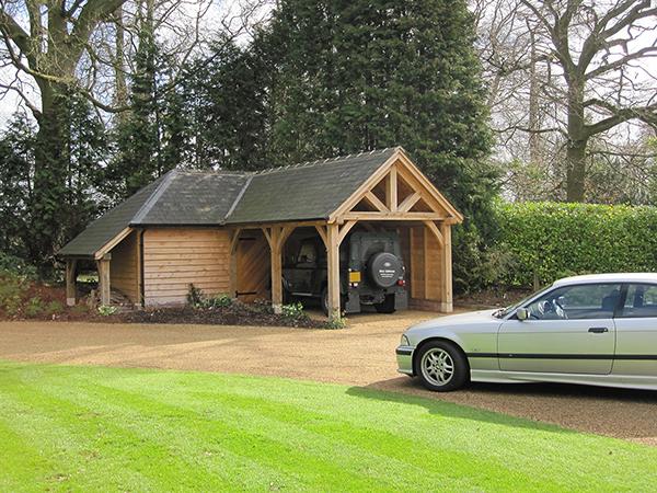 Oak framed L-shaped garage project by Shires Oak Buildings