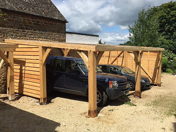 Oak framed vehicle shelter project by Shires Oak Buildings