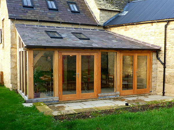 Oak framed lean-to extension by Shires Oak Buildings