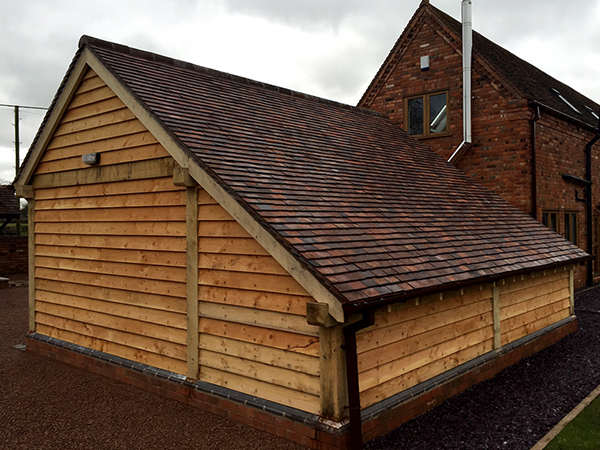 2 bay garage with catslide, rear and side elevation, by Shires Oak Buildings