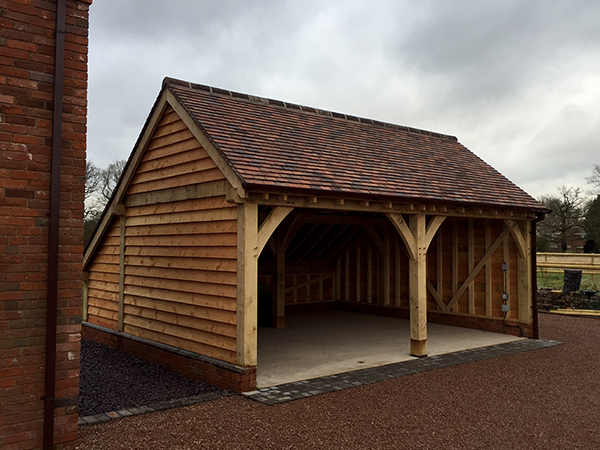 2 bay garage with catslide, side elevation, by Shires Oak Buildings
