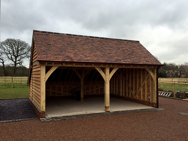 2 bay garage with open bays by Shires Oak Buildings