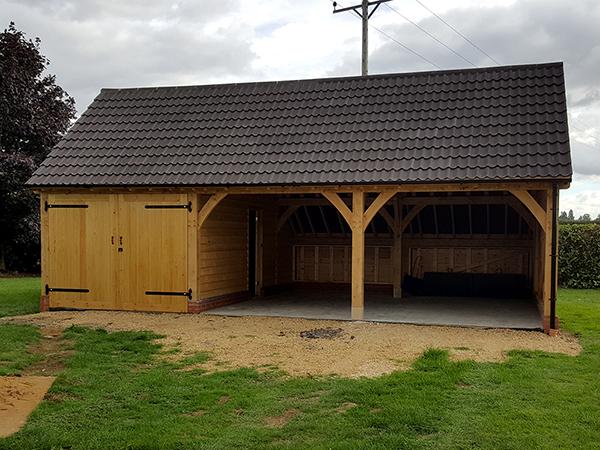 Oak framed 3 bay garage by Shires Oak Buildings