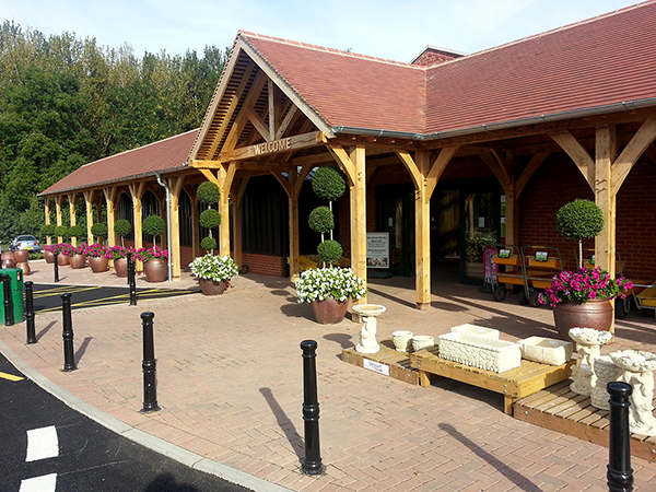 Oak framed porch and walkway for Mappleborough Green Garden Centre by Shires Oak Buildings