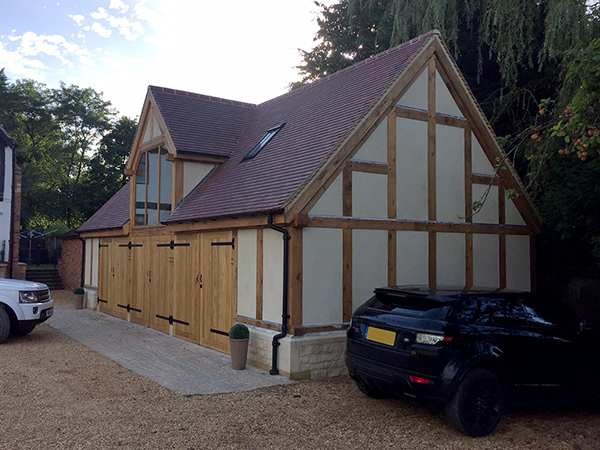 Oak framed garage outbuilding by Shires Oak Buildings
