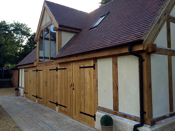 Oak framed garage outbuilding by Shires Oak Buildings