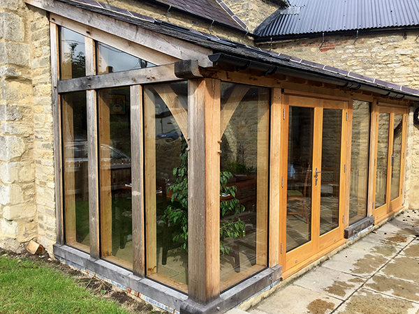 Oak framed lean-to extension by Shires Oak Buildings