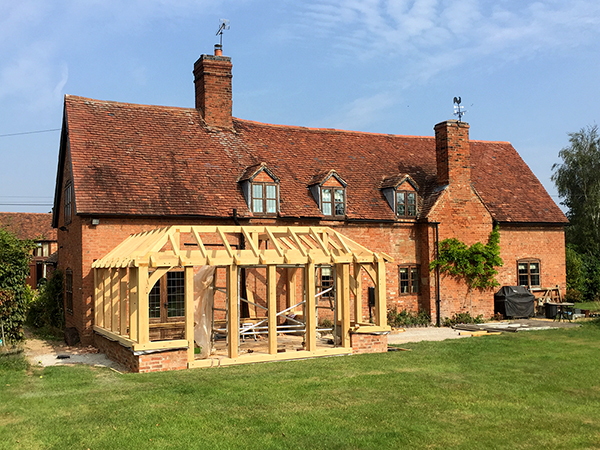 Oak framed orangery, under construction, by Shires Oak Buildings