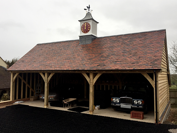 Oak framed 3 bay garage with clock tower by Shires Oak Buildings