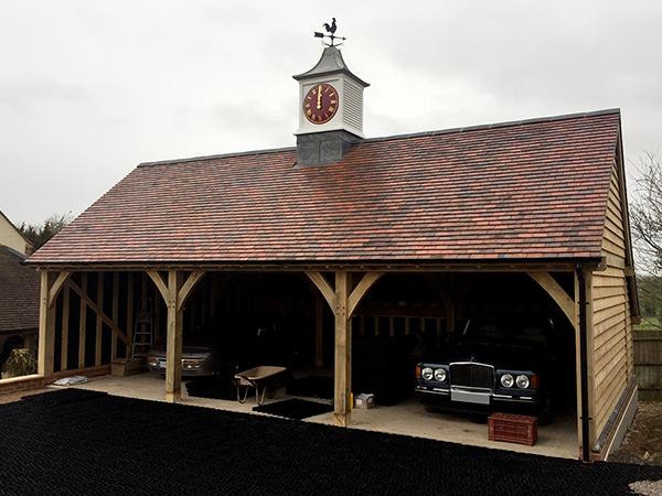 Oak framed 3 bay garage with clock tower by Shires Oak Buildings