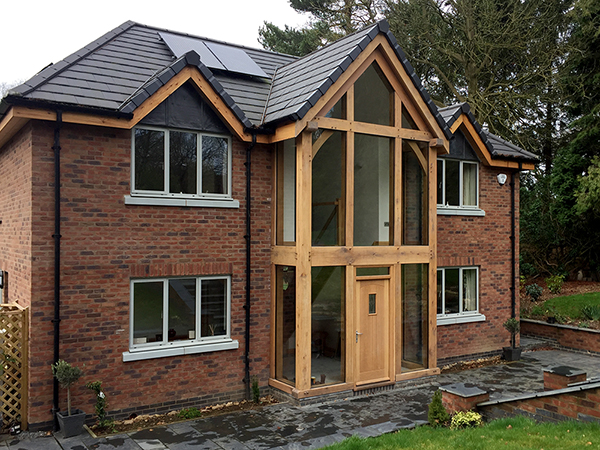 Oak framed and glazed 2 storey entrance porch by Shires Oak Buildings