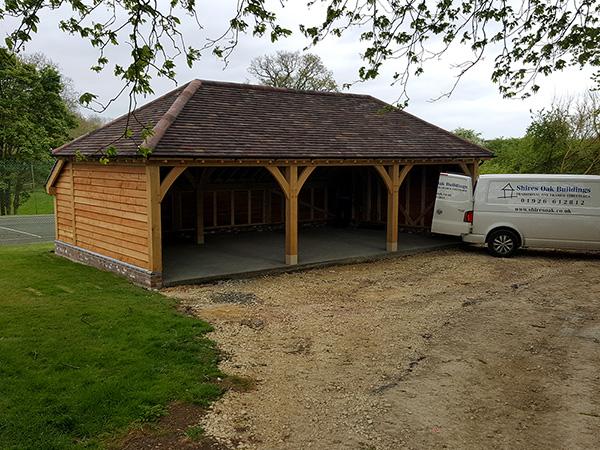 Oak framed 3 bay garage, hipped roof, by Shires Oak Buildings