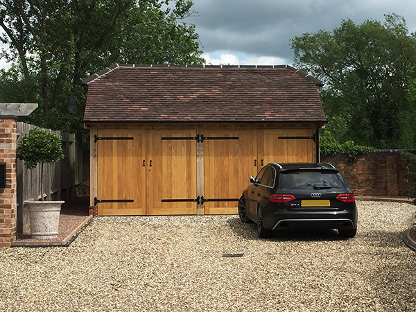 2 Bay garage with barn hip roof by Shires Oak Buildings