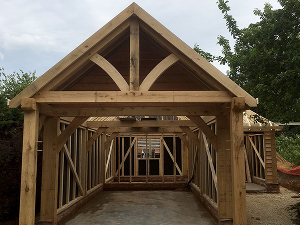 Oak framed garage and workshop, under construction, by Shires Oak Buildings