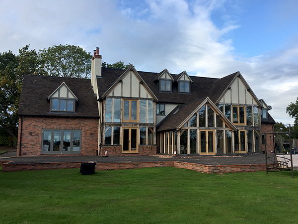 Oak framed garden room and gable extensions by Shires Oak Buildings