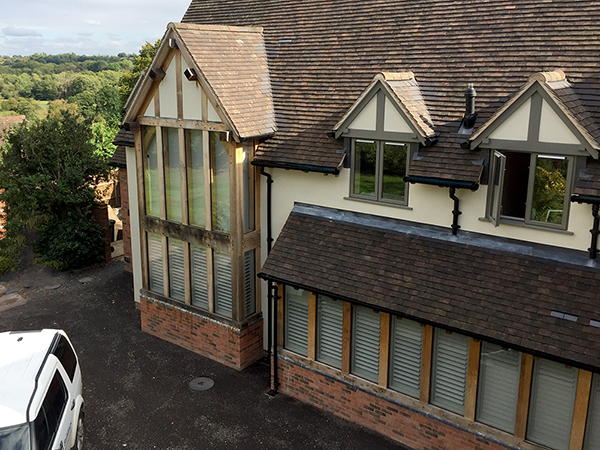 Oak framed single storey and 2 storey glazed extensions by Shires Oak Buildings