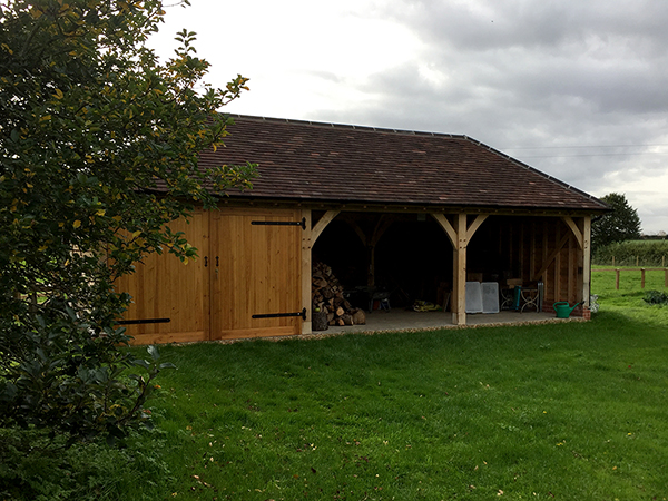 Oak framed 3 Bay Garage with hipped roof and 2 open bays by Shires Oak Buildings