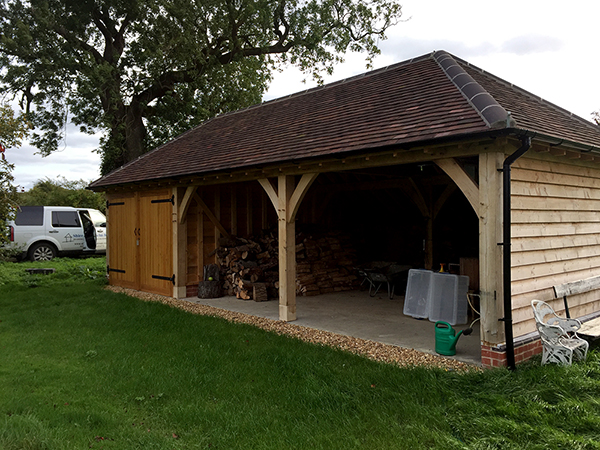 Oak framed 3 Bay Garage with hipped roof by Shires Oak Buildings