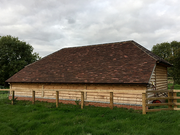 Oak framed 3 Bay Garage with fully hipped roof by Shires Oak Buildings