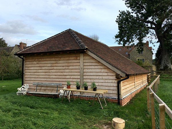 Oak framed 3 Bay Garage with hipped roof, side elevation, by Shires Oak Buildings