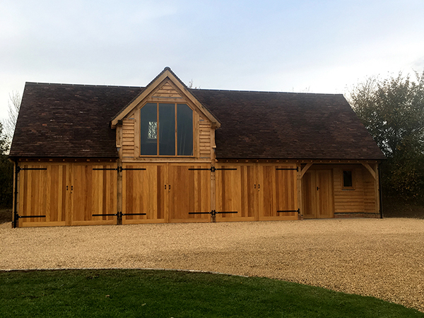 Oak framed 4 bay garage & workshop constructed by Shires Oak Buildings