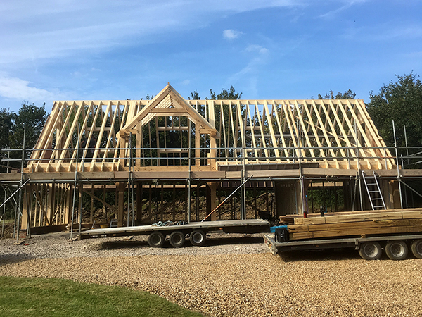 Oak framed 4 bay garage & workshop, under construction, by Shires Oak Buildings
