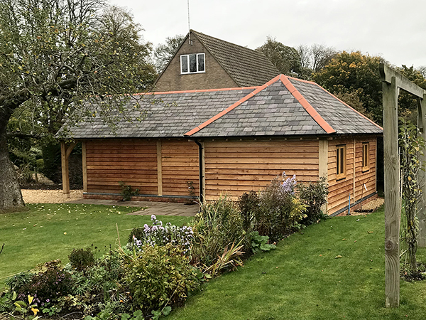 Oak framed L-shaped garage & workshop, rear view, by Shires Oak Buildings