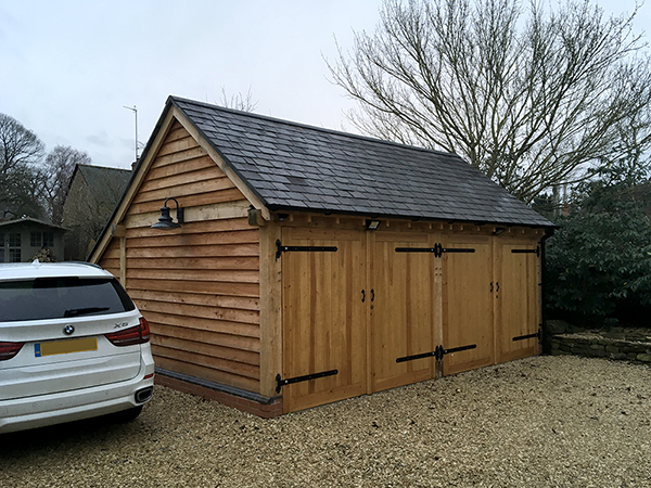 Oak framed 2 bay garage with doors by Shires Oak Buildings