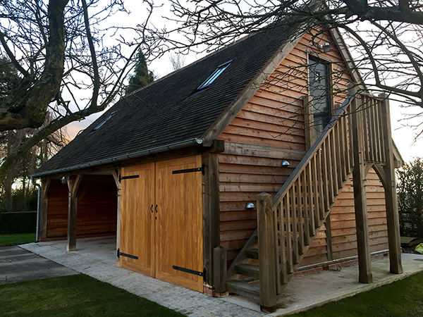 Oak framed 3 Bay Garage with storage above & external stairs, by Shires Oak Buildings