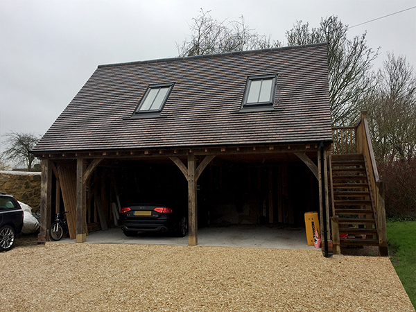 Oak framed 2 bay garage with room above & external stairs, by Shires Oak Buildings