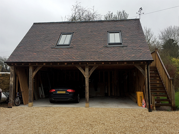 Oak framed 2 bay room over garage with external stairs by Shires Oak Buildings