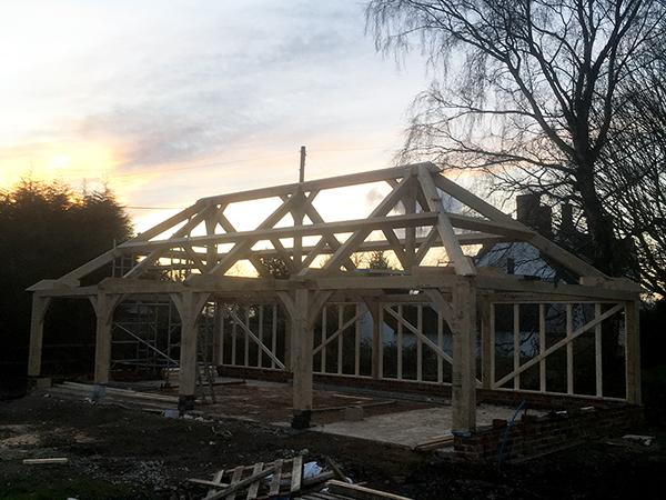 Oak framed 4 bay garage, under construction, by Shires Oak Buildings