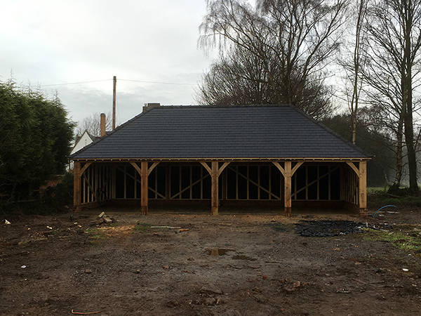 Oak framed 4 bay garage with hipped roof by Shires Oak Buildings
