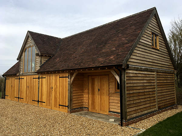 Oak framed 4 bay room over garage & workshop with hayloft dormer by Shires Oak Buildings