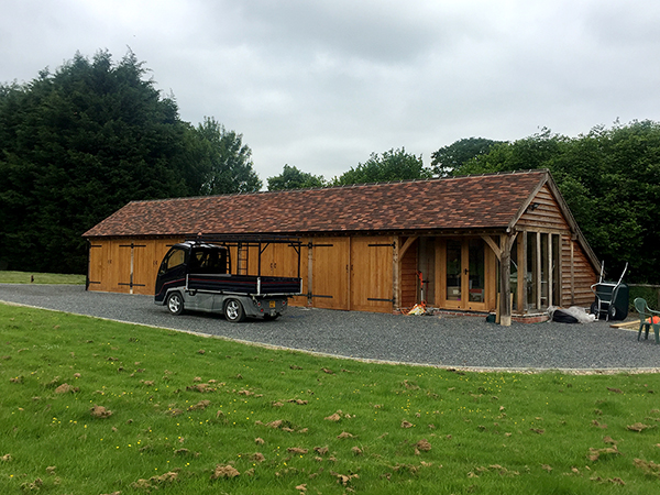 Oak framed 6 bay garage and office by Shires Oak Buildings