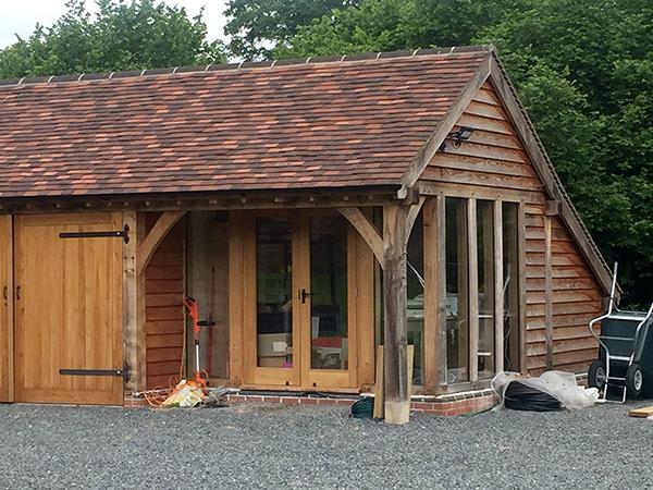 Oak framed 6 bay garage, office detail, by Shires Oak Buildings