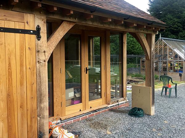 Oak framed 6 bay garage, office bay detail, by Shires Oak Buildings