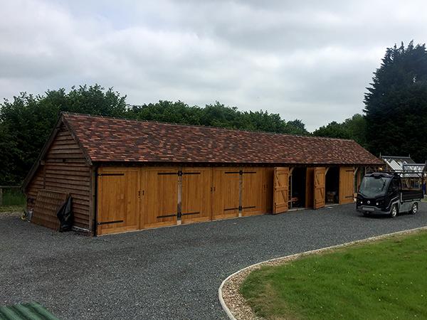Oak framed 6 bay garage with 1 bay as office, by Shires Oak Buildings