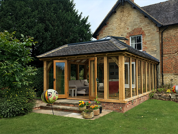 Oak framed orangery with mansard roof by Shires Oak Buildings