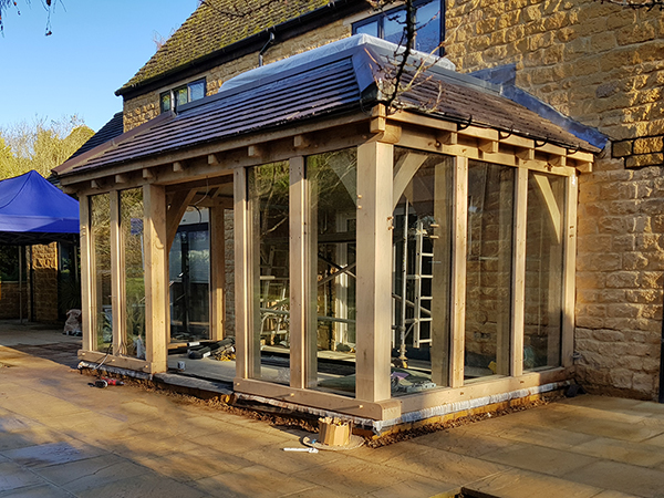 Oak framed orangery, during construction, by Shires Oak Buildings