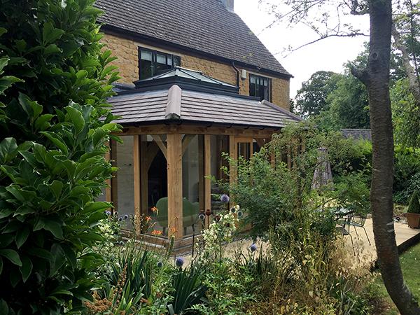 Oak framed orangery, garden view, by Shires Oak Buildings