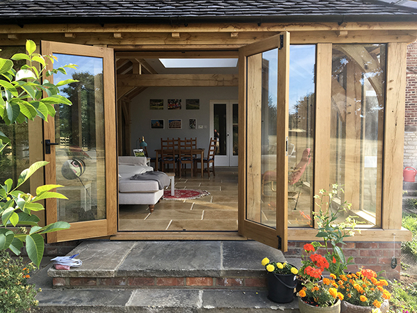 Oak framed orangery, view through French Doors, by Shires Oak Buildings